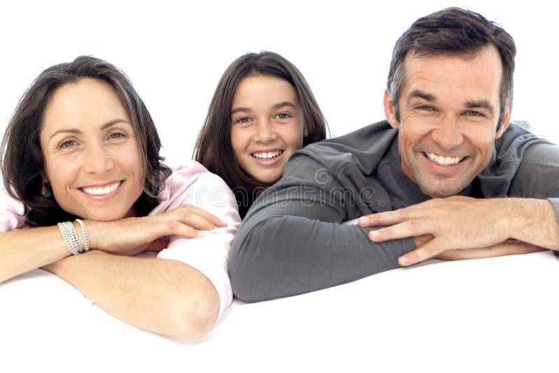 Lycklig familj med ett barn royaltyfria foton