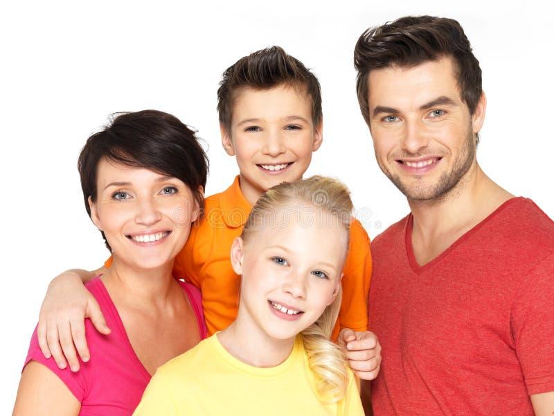 Lycklig familj med två barn på vit royaltyfri foto