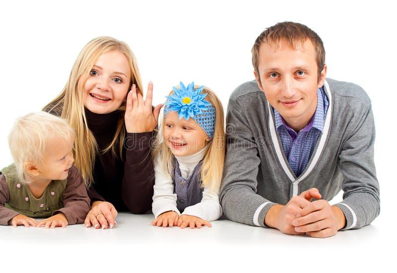Lycklig familj med ungt barn royaltyfri bild