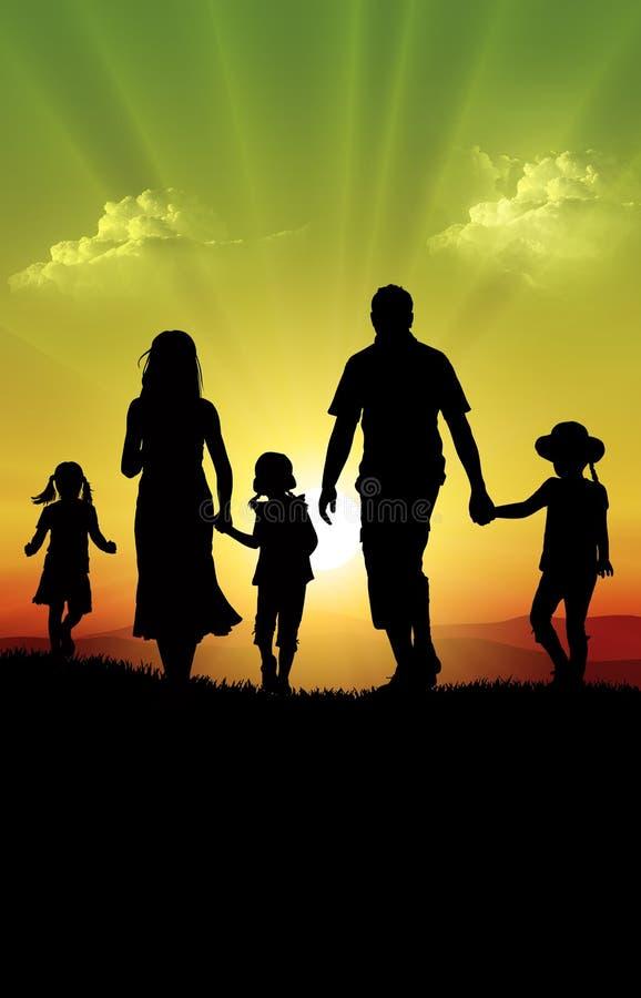 Lycklig familj på solnedgången arkivfoton