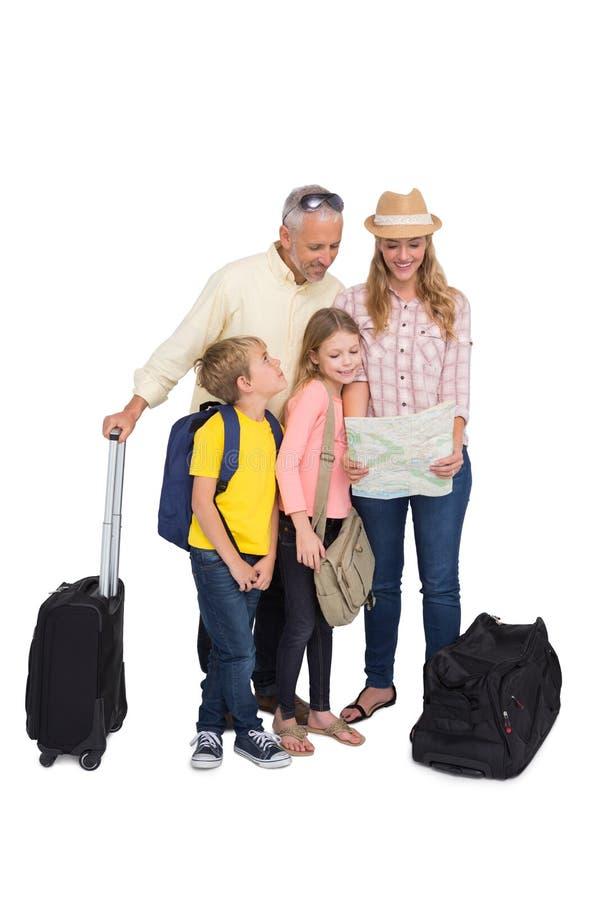 Lycklig familj som är klar för en ferie fotografering för bildbyråer
