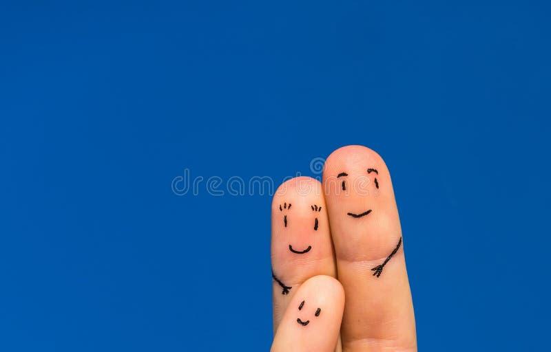 Lycklig fingerfamilj arkivfoton