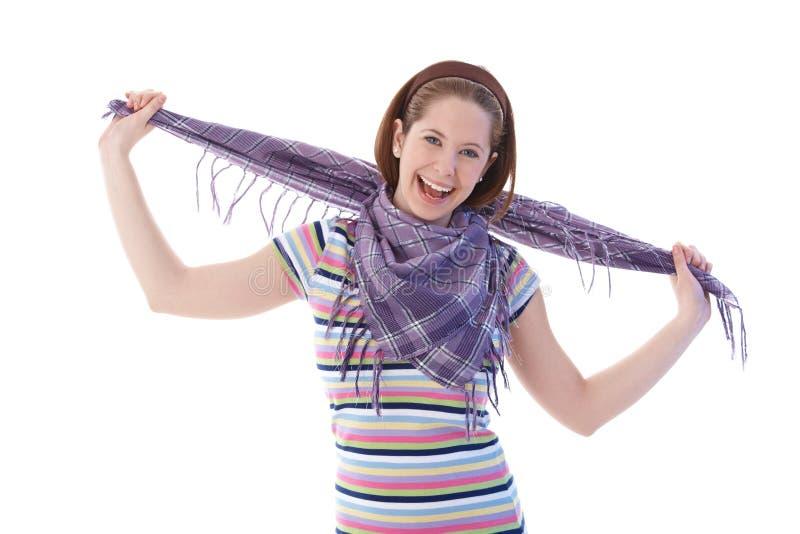 Lycklig flicka i scarf och t-shirt arkivbilder