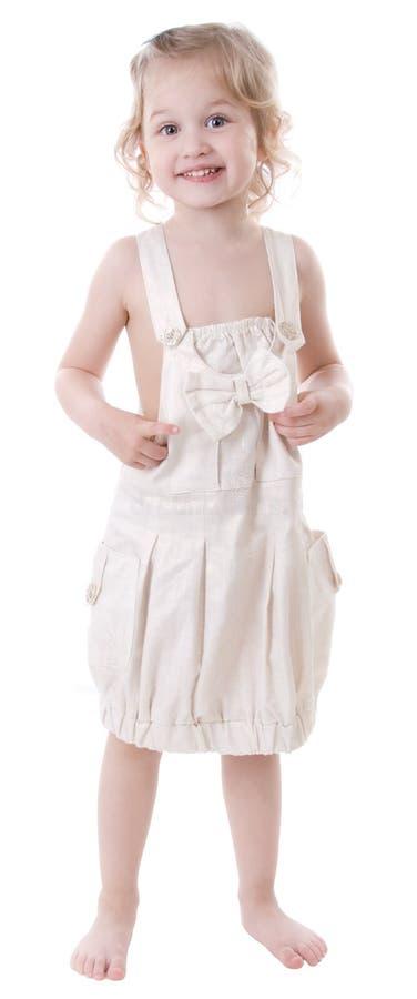 lycklig flicka little som plattforer royaltyfri foto