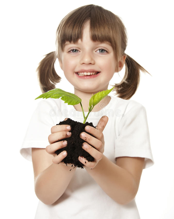 lycklig flicka little växt fotografering för bildbyråer
