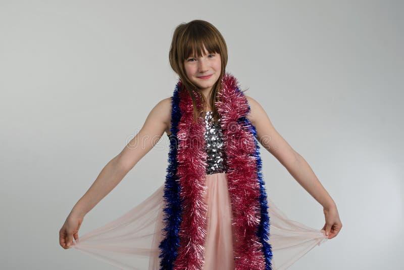 Lycklig flicka med garneringar X-mas royaltyfri fotografi