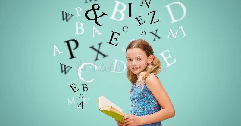 Lycklig flickainnehavbok medan bokstäver som flyger i bakgrund royaltyfria foton