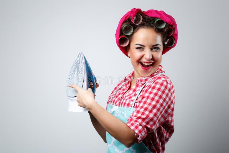 Lycklig galen flicka med järn arkivbild