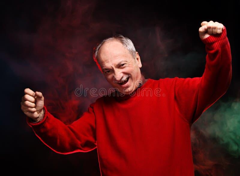 Lycklig gamal man royaltyfri foto