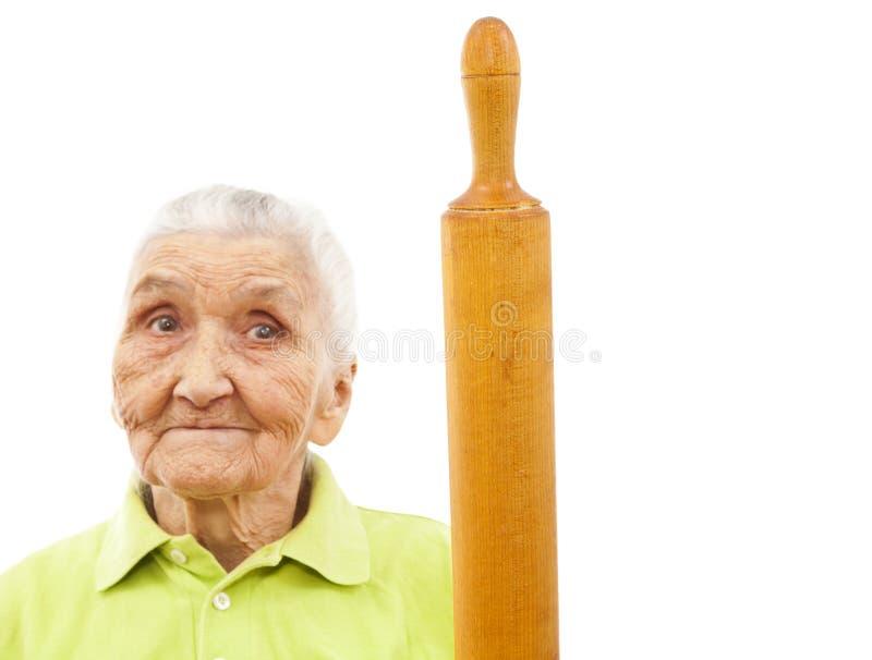 lycklig gammal stiftrullningskvinna fotografering för bildbyråer