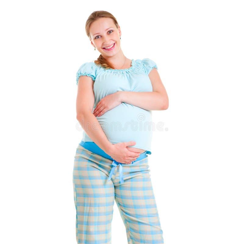lycklig gravid pyjamaskvinna arkivbild