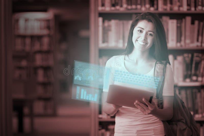 Lycklig gullig student som arbetar på hennes futuristiska minnestavlaPC royaltyfri foto