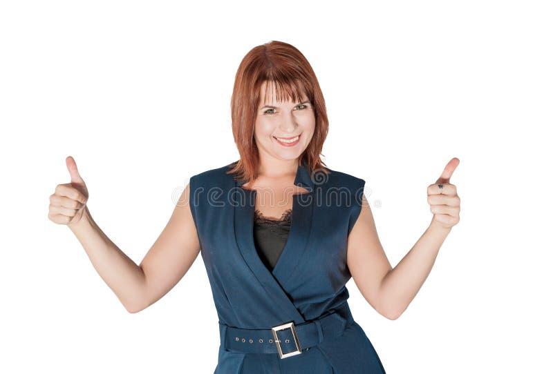 Lycklig härlig affärskvinna som visar tummar som isoleras upp royaltyfri fotografi