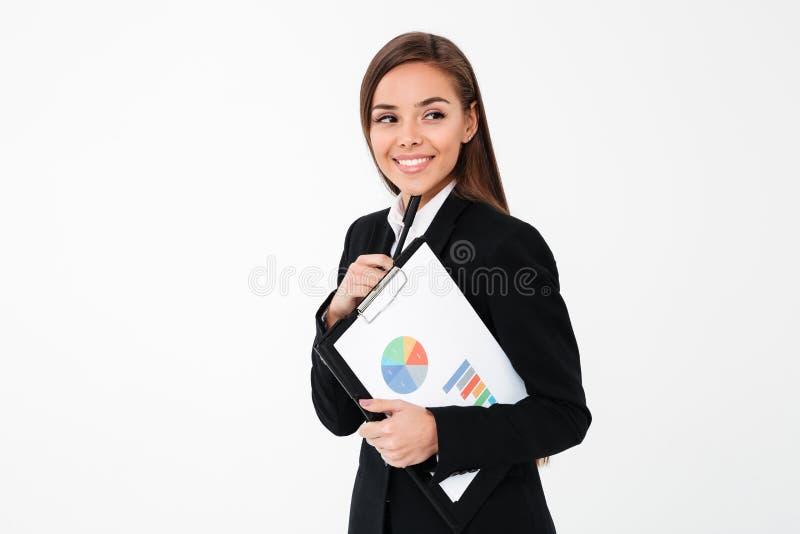 Lycklig hållande skrivplatta för affärskvinna åt sidan se fotografering för bildbyråer
