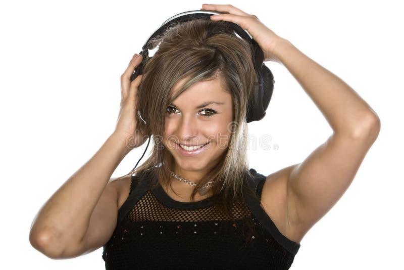 lycklig hörlurar för brunett som lyssnar till arkivbild