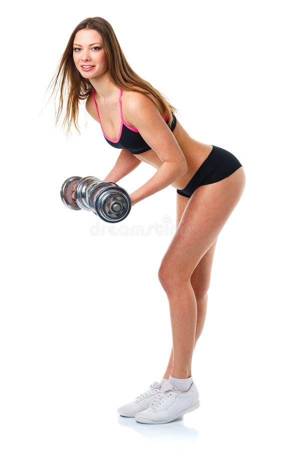 Lycklig idrotts- kvinna med hantlar som gör sportövningen, isolat royaltyfri foto