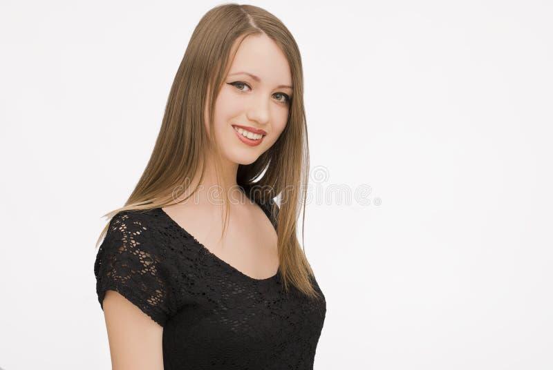 Lycklig isolat för ung kvinna royaltyfria foton