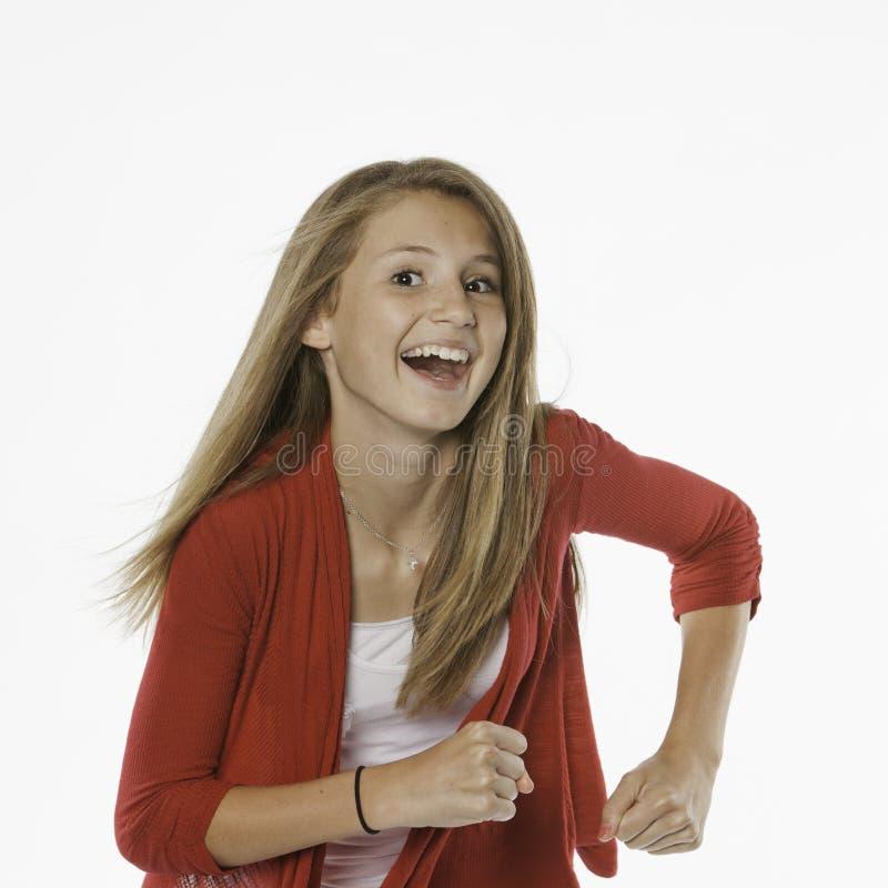 lycklig isolerad tonårs- white för kvinnlig royaltyfri foto