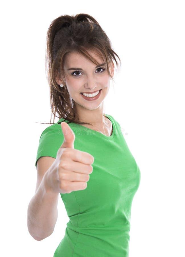 Lycklig isolerad ung kvinna som bär den gröna skjortadanandetummen upp G fotografering för bildbyråer