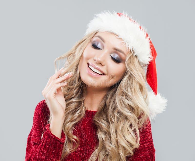 Lycklig jultomtenflicka i julhatt övre framsidastående för slut arkivfoton