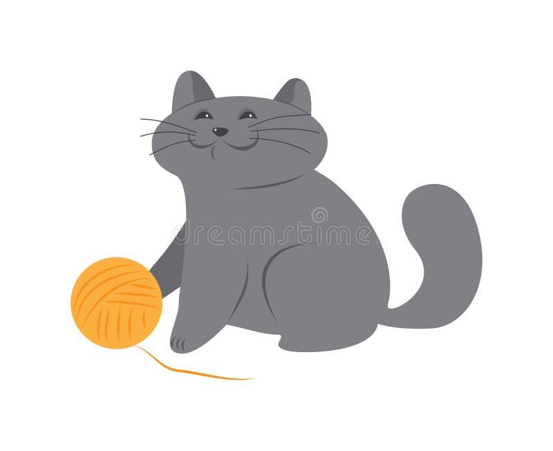 Lycklig kattunge med en boll av ull arkivbild