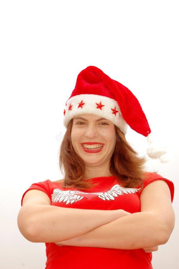 Lycklig kvinna i den Santa hatten arkivbilder