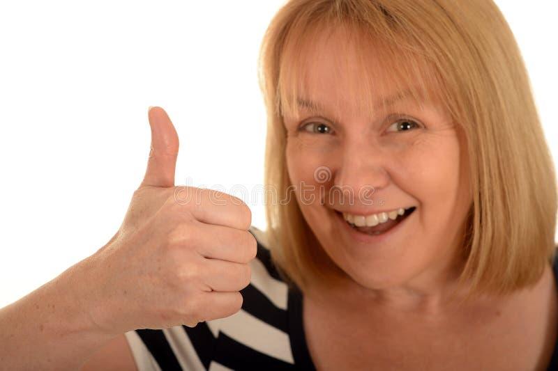 Lycklig kvinna med tummen upp royaltyfria bilder
