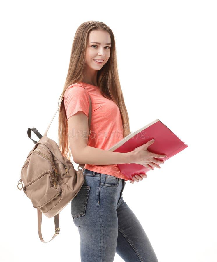 Lycklig kvinnlig student med böcker och ryggsäcken Isolerat på vit arkivbilder