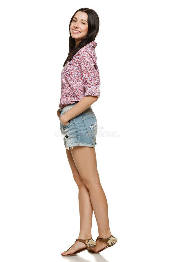 Lycklig kvinnligstanding royaltyfri foto