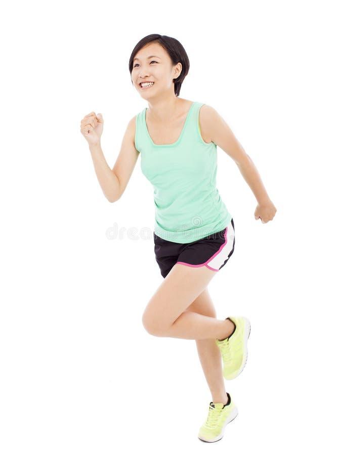 Lycklig löpare för ung kvinna som isoleras på vit arkivfoton