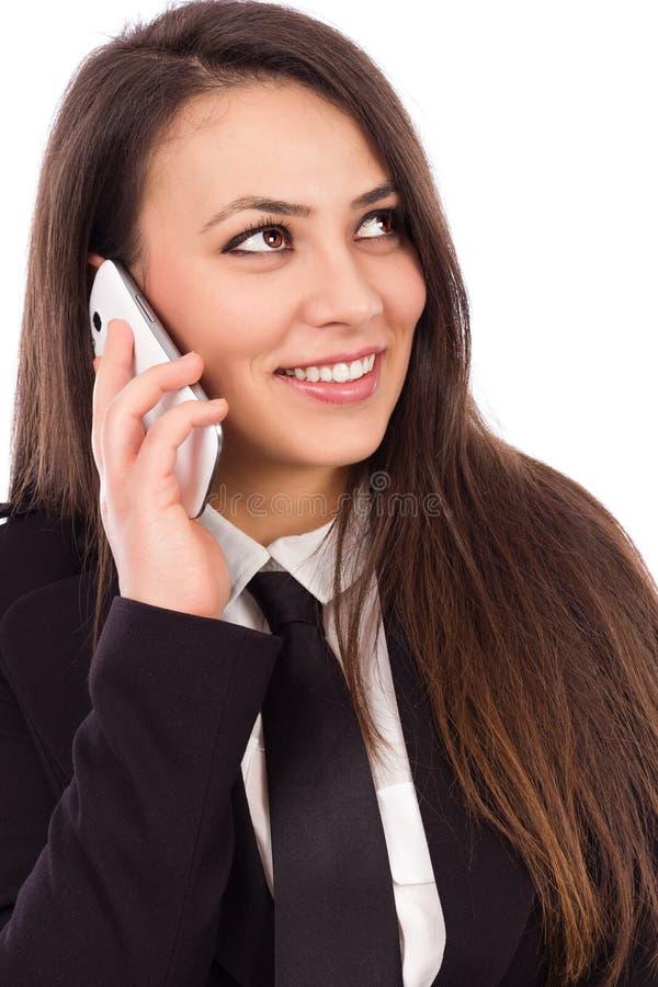 Lycklig le lyckad affärskvinna med mobiltelefonen royaltyfri fotografi