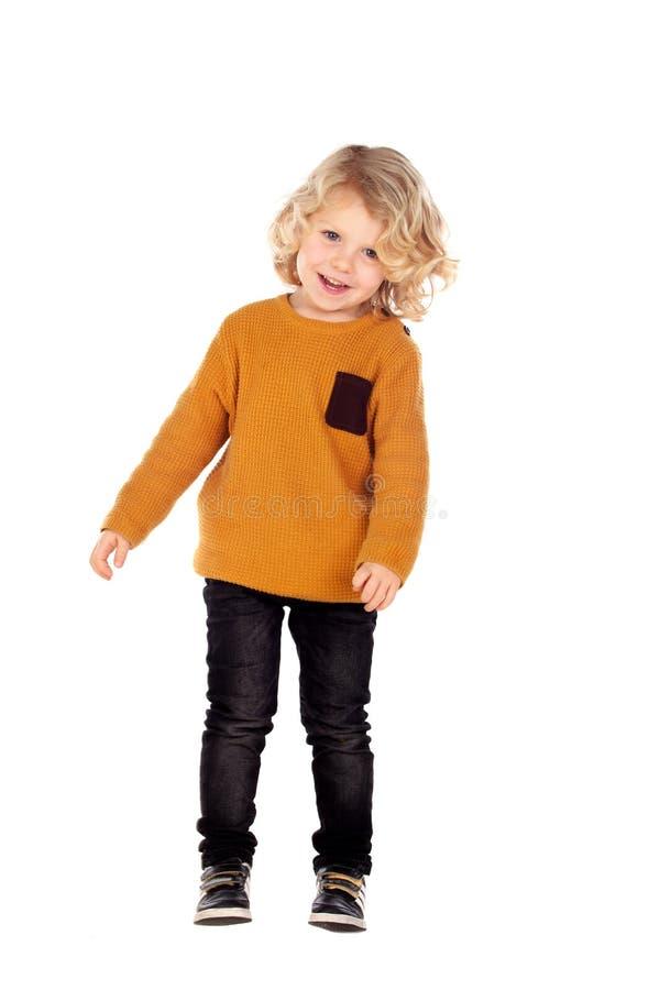 Lycklig liten blond ärmlös tröja för barnwhithguling royaltyfri bild