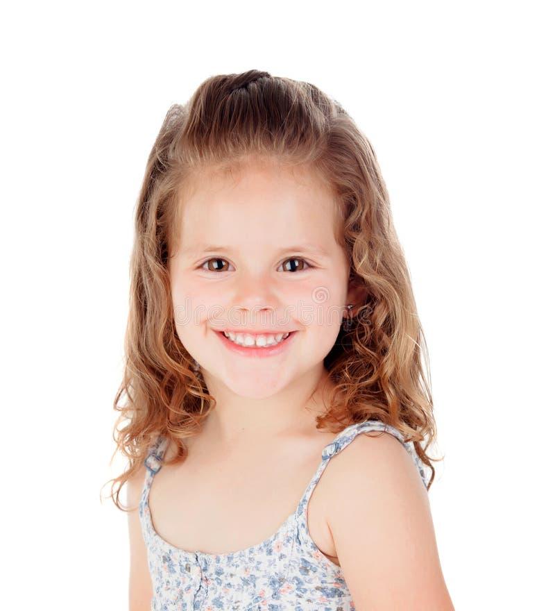 Lycklig liten flicka med långt rakt hår arkivfoton