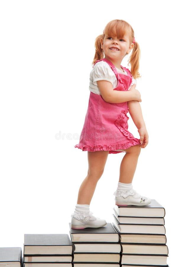 lycklig liten skola för flicka royaltyfria bilder