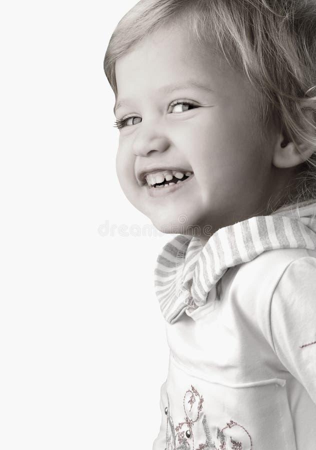 lycklig liten smiley för tät flicka upp fotografering för bildbyråer