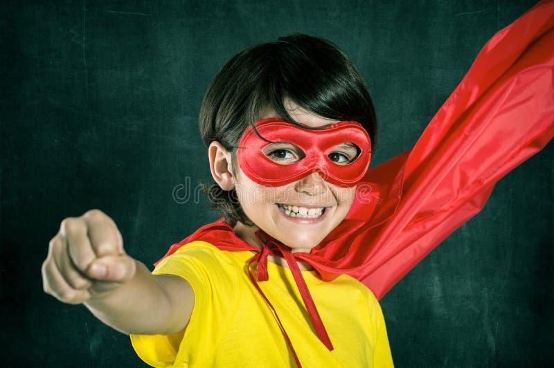 Lycklig liten superhero royaltyfria bilder