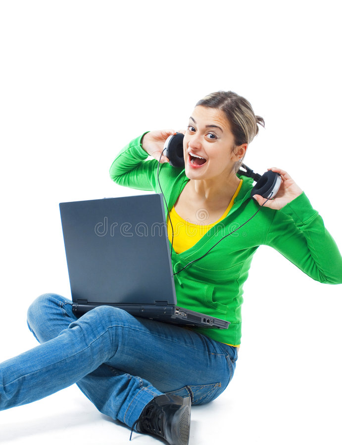 lycklig lyssnande musik för flicka till royaltyfri fotografi