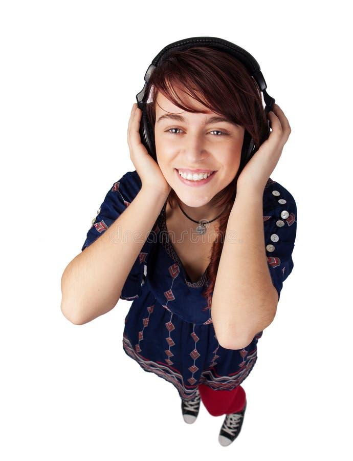 lycklig lyssnande teen kvinna för musik arkivbilder