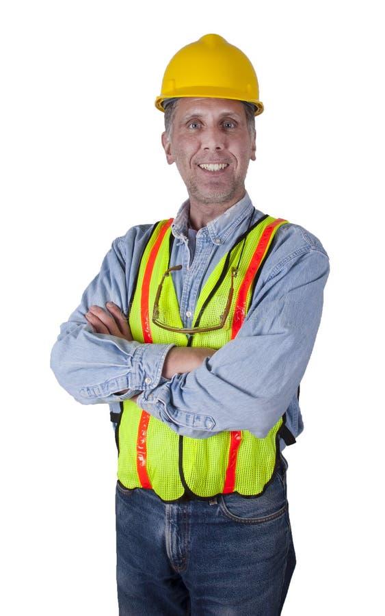 lycklig man för konstruktion som ler den fackliga arbetaren arkivbild