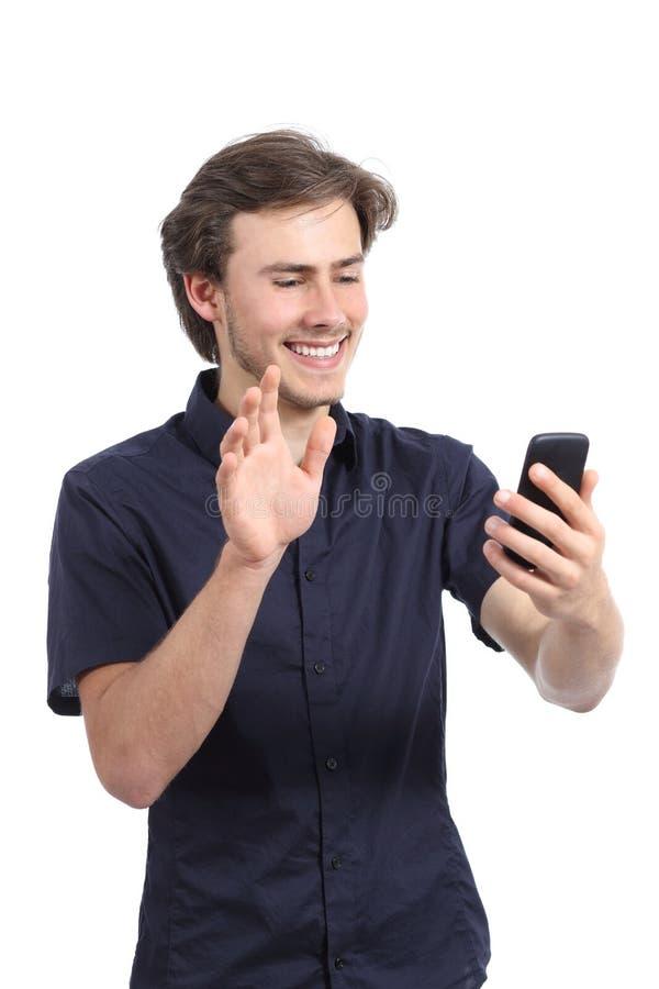 Lycklig man som vinkar till en smart telefonkamera arkivbilder