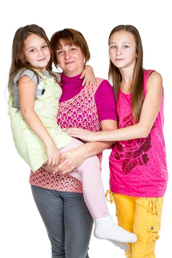 Lycklig moder och två döttrar royaltyfria foton