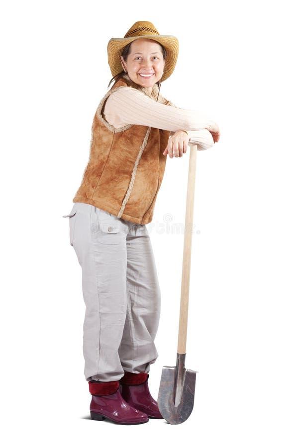 Lycklig mogen kvinna med spaden royaltyfria bilder
