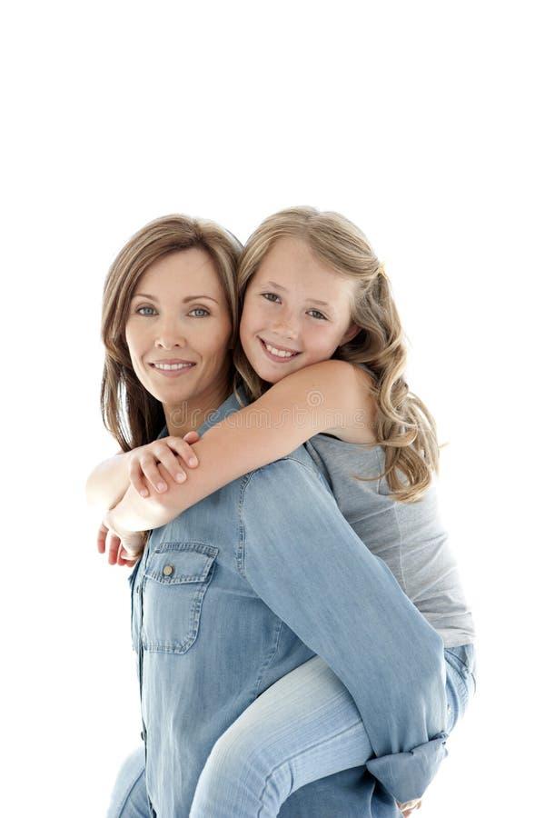 Lycklig mum och dotter som har gyckel royaltyfria foton