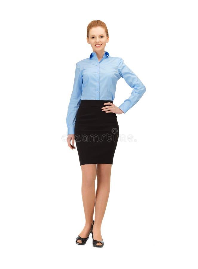 Lycklig och le stewardess arkivbild