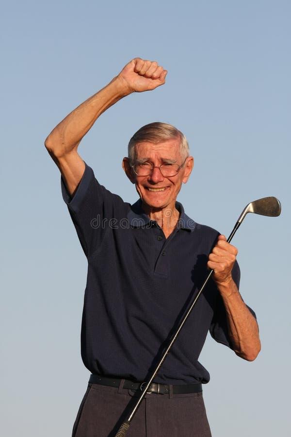 lycklig pensionär för golfare arkivbild