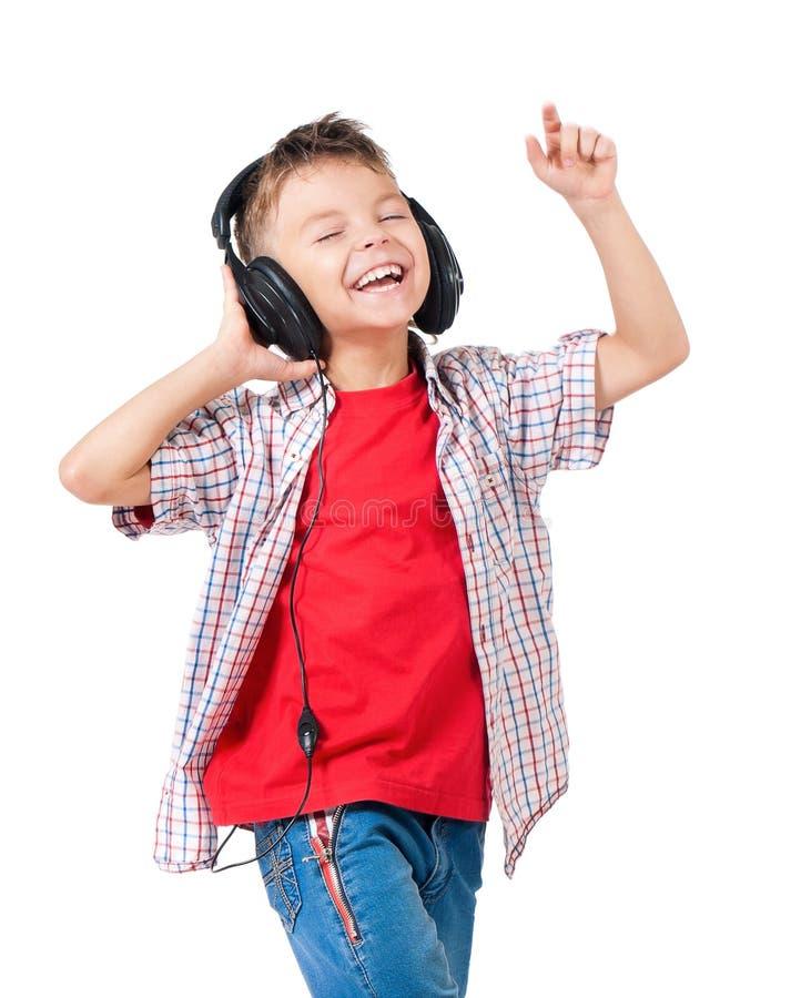 Lycklig pojke med hörlurar arkivfoton