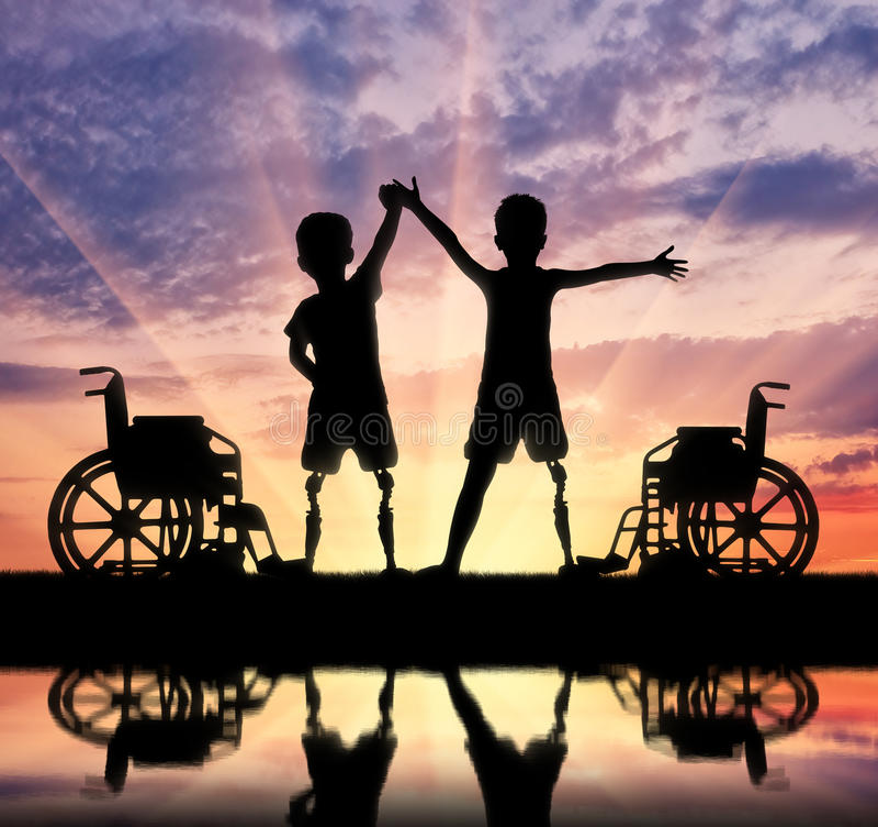 Lycklig pojke två med ett handikapp arkivfoton