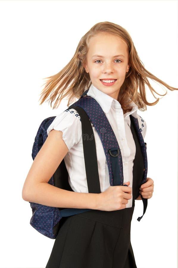 Lycklig schoolgirl med ryggsäck arkivfoton