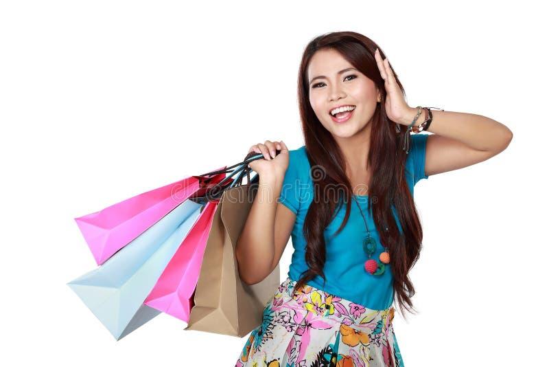 lycklig shopping för flicka mycket arkivfoto