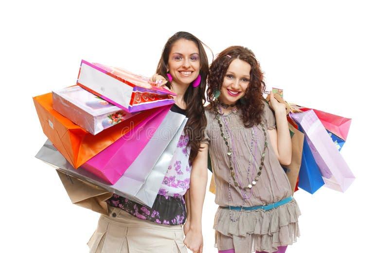 lycklig shopping för vänner royaltyfria foton